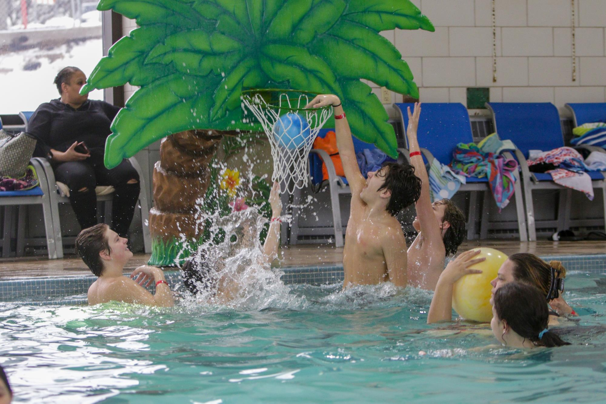 children playing water basketball
