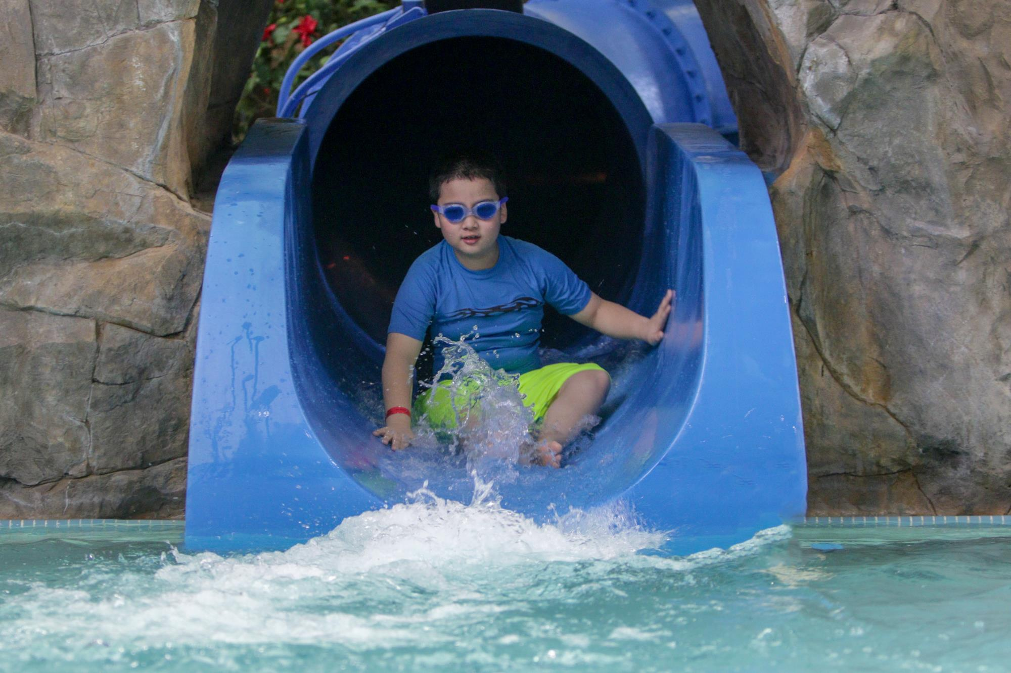child on the shark attack waterslide