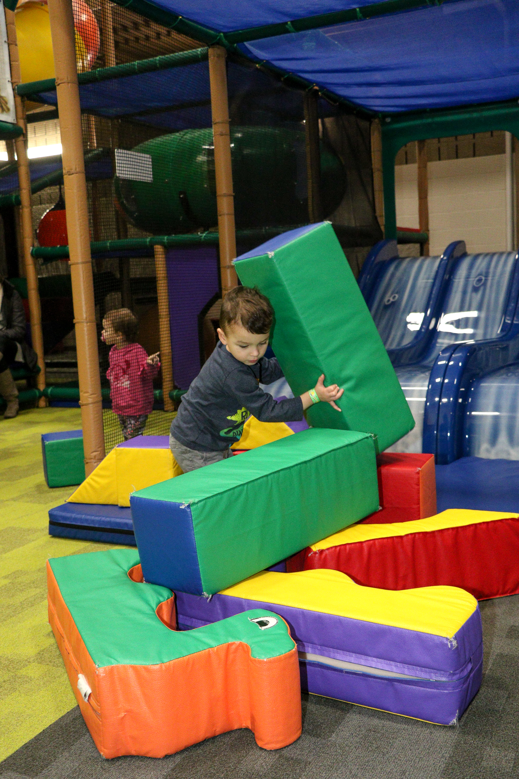 child with blocks in the toddler area